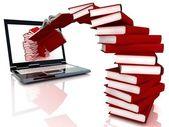Libros rojos volar en portátil — Foto de Stock