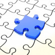 White jigsaw puzzles with one blue piece — Stock Photo