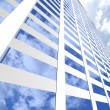 Modern skyscraper on cloudscape background — Stock Photo #10011012