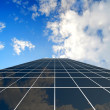 Modern skyscraper on cloudscape background — Stock Photo #10011026