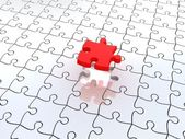 Puzzle in pieces over a white background — Stock Photo