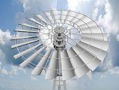 Uma turbina de vento única sobre uma nuvem encheu o céu azul. — Foto Stock