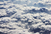 Flying in the clouds — Stock Photo