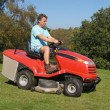 Man Cutting his Lawn — Stock Photo #9931045
