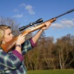 Girl With Rifle — Stock Photo #9937008