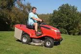 Man Cutting his Lawn — Stock Photo
