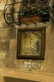 Religious panel above doorway in Italian village — Stock Photo