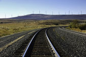 Wind turbines and railroad tracks. — Stock Photo