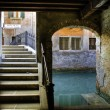 Stairs, archway and canal in Venice — Stock Photo #10338148