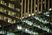 Urban buildings reflected in the glass windows of skyscrapers. — Foto de Stock