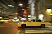 Taxi at night, blurred with motion — Stock Photo
