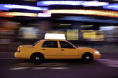 Taxi at night, with copyspace available. — Stock Photo