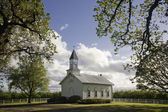 Old white rural church — Stock Photo