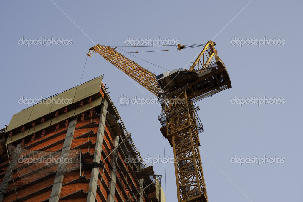 Construction cranes at work putting up high rise buildings. — Stock Photo #10330482