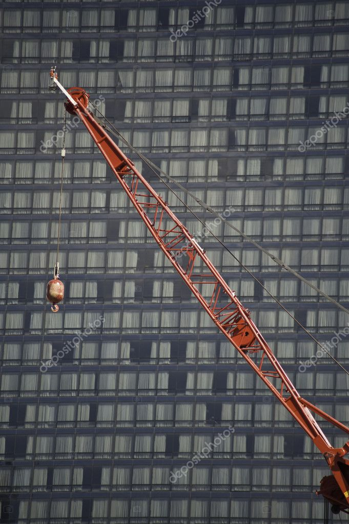 Construction cranes at work putting up high rise buildings. — Foto Stock #10330544