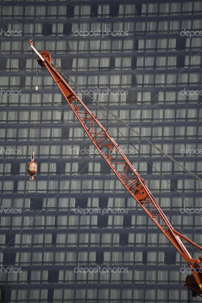 Construction cranes at work putting up high rise buildings. — Stockfoto #10330544