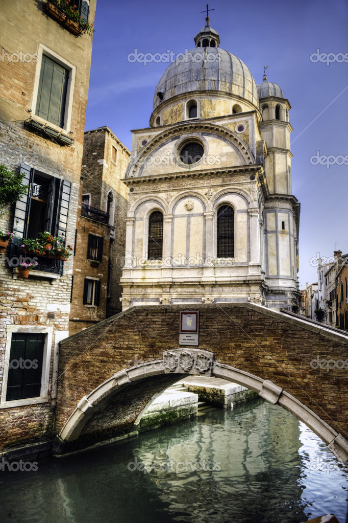 Church of Santa Maria dei Miracoli, in Venice, by a canal  Stock Photo #10345770