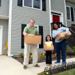 A Family Moving Into New House — Stock Photo