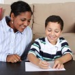 Woman and Boy Writing — Stock Photo #10002194