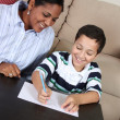 Woman and Boy Writing - Stock Photo