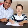 Woman and Boy Writing — Stock Photo #10002200