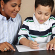 Woman and Boy Writing — Stock Photo #10002205