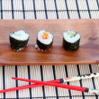 Stock Photo: Sushi on placemat
