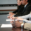 Business Team Signing Contracts - Stock Photo