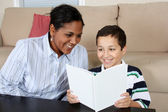 Woman and Boy Reading Book — Stock Photo