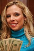 Woman Holding Money — Stockfoto