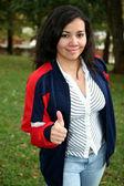 Teenager on Campus Thumbs Up — Stockfoto
