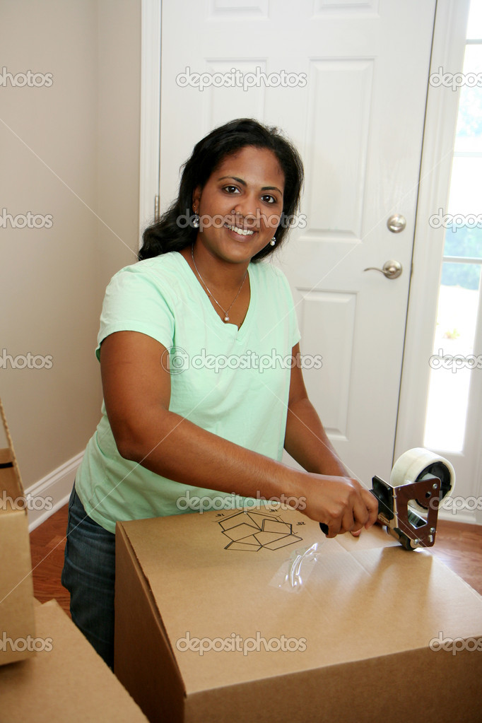 Family moving into a new home — Stock Photo #10002204