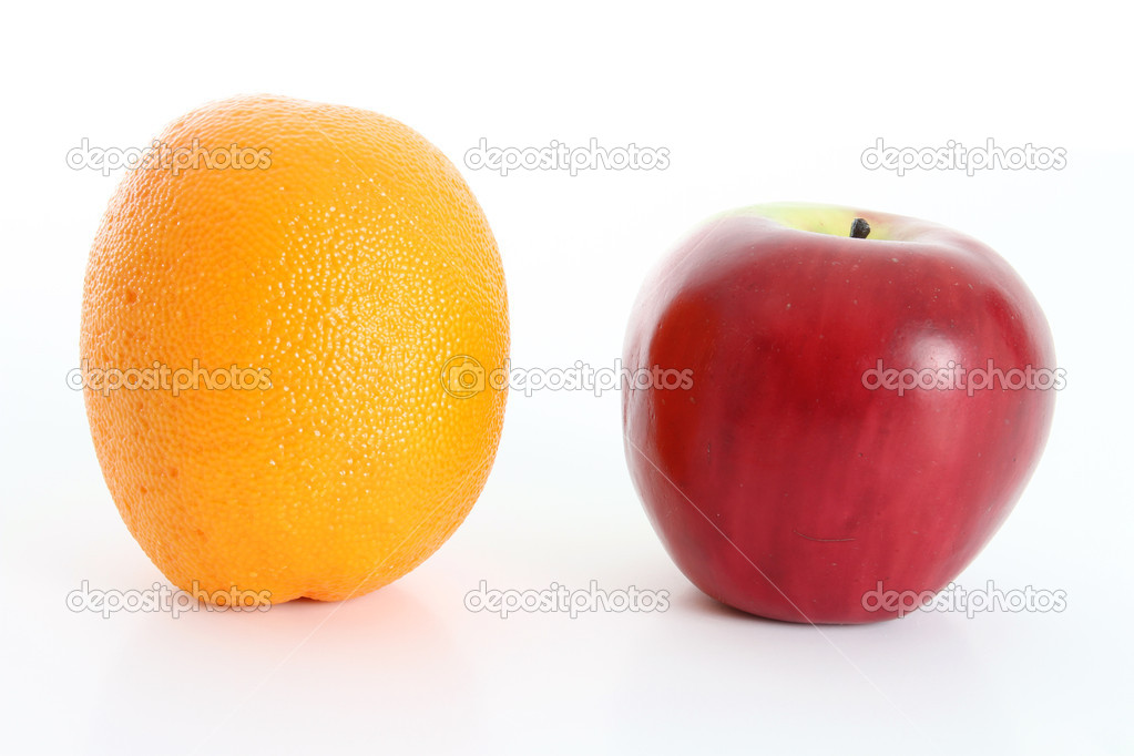 Comparing apples to oranges on white background  Stock Photo #10003669