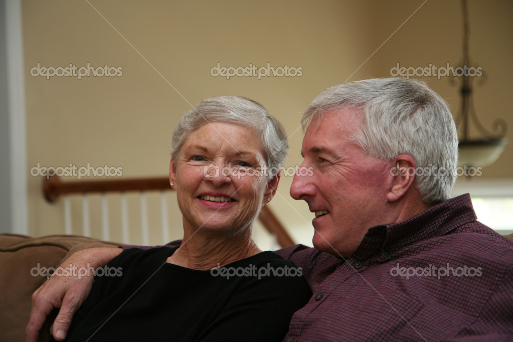 Happy Senior Couple smiling outside  Stock Photo #10004836