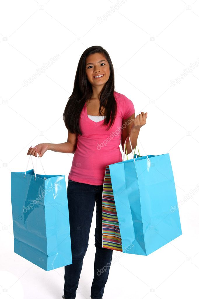 Teen girl shopping with bags on white background  Stock Photo #10105862