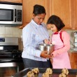 Girl And Mother With Cookies — Stock Photo