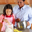 Girl And Mother Cooking — Stock Photo