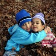 Two Children In Leaves — Stock Photo #9996251