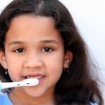 Girl Talking Brushing Teeth — Stock Photo #9996256