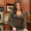 Woman In Her Kitchen — Stock Photo #9998727