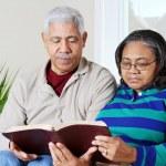 Senior Hipanic Couple Reading Bible — Stock Photo #9999677