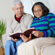Senior Hipanic Couple Reading Bible — Stock Photo