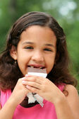 Young Girl Eating Chocolate — Stock Photo