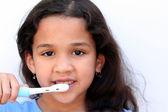 Girl Talking Brushing Teeth — Stock Photo