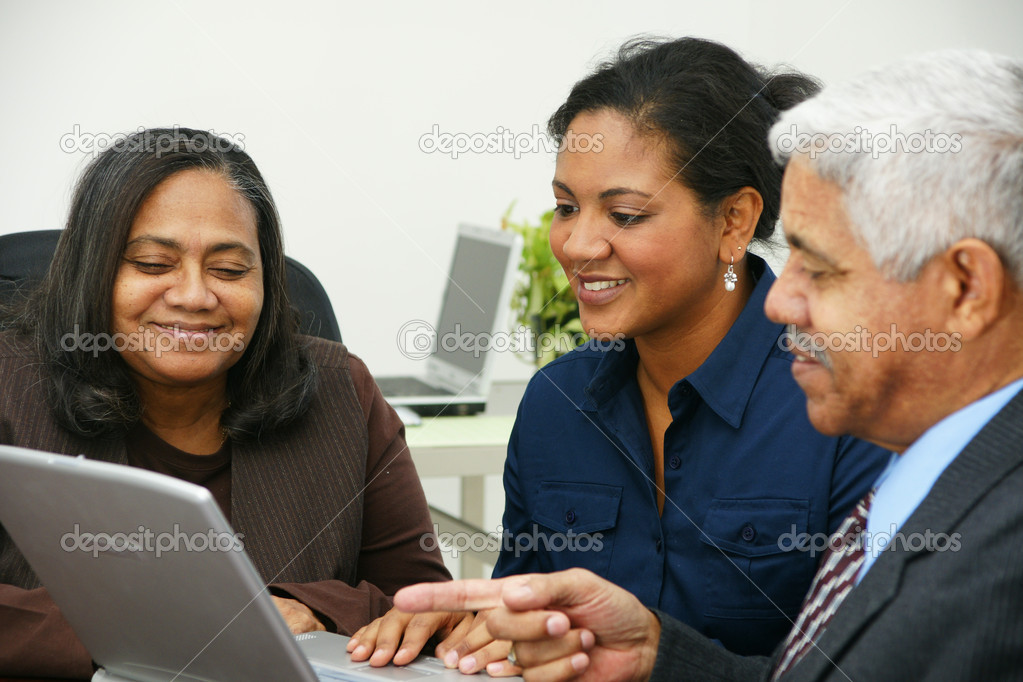 Team of business working together in an office — Stock Photo #9996959