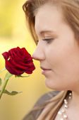 Young woman with a rose — Stock Photo