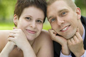 Portrait of young couple in the park — Stock Photo