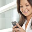 Businesswoman using a cell phone — Stock Photo