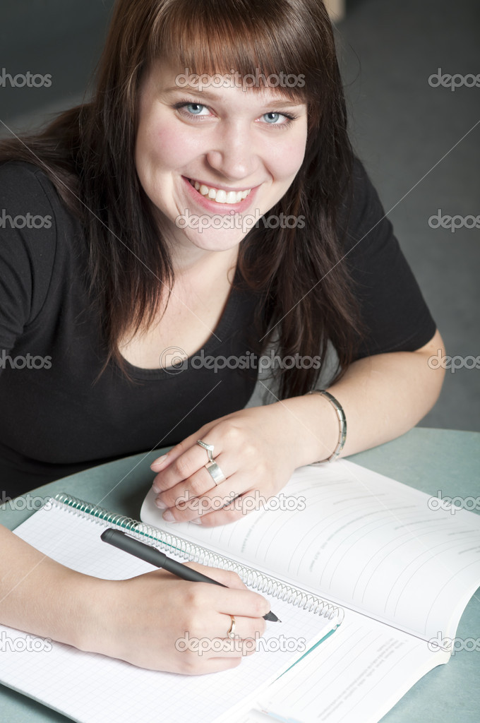 Portrait of young student studing at library  Stock Photo #10153655