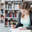 Female student studying — Foto de stock #10399893